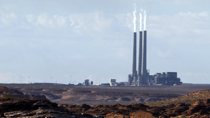 "FILE - In this Sept. 4, 2011 file photo shows the main plant facility at the Navajo Generating Station, from Lake Powell, in Page, Ariz. The United Nations climate chief is urging people not to look solely to their governments to make tough decisions to slow global warming, and instead to consider their own role in solving the problem. Approaching the half-way point of two-week climate talks in Doha, Christiana Figueres, the head of the U.N.'s climate change secretariat, said Friday, Nov. 30, 2012 that she didn't see ""much public interest, support, for governments to take on more ambitious and more courageous decisions.""(AP Photo/Ross D. Franklin, File)"