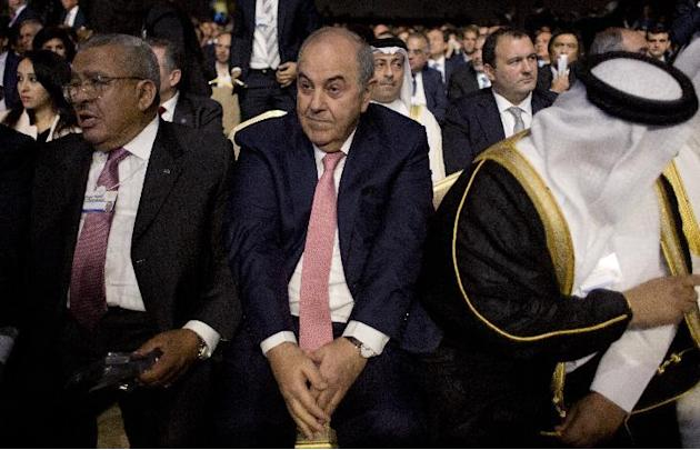 Iraq's Vice President Iyad Allawi, center, attends the opening session of the World Economic Forum at the King Hussein convention center, Southern Shuneh, Jordan, Friday, May 22, 2015. Top politic