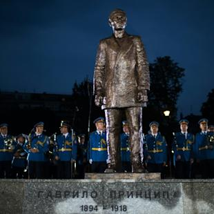 Serbian army honour guard stands behind the bronze statue of Gavrilo Princip after an unveiling ceremony at a park in downtown Belgrade on June 28, 2015
