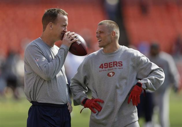 Denver Broncos quarterback Peyton Manning, left, talks with San Francisco 49ers wide receiver Austin Collie, right, before an NFL preseason football game on Thursday, Aug. 8, 2013 in San Francisco. B.