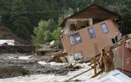 A destroyed house with one of its walls still clinging on is seen in Jamestown, Colorado, after a flash flood destroyed much of the town, September 14, 2013. REUTERS/Rick Wilking