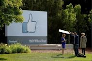 A television crew prepares for a broadcast in front of a 'like' sign outside Facebook headquarters in Menlo Park, California. Facebook stumbled in its first trading day Friday as shares ended barely above the starting price after a glitch-plagued market debut on the Nasdaq that failed to live up to the enormous hype