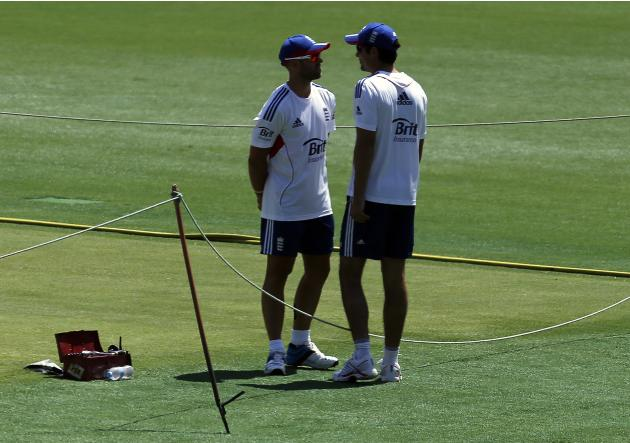 England's cricket team captain Cook talks with teammate Prior during a training session in Brisbane