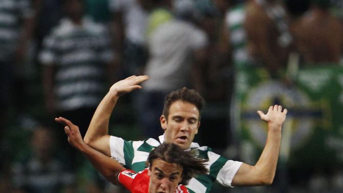 Sporting's Capel fights for the ball with Benfica's Markovic during their Portuguese Premier League soccer match in Lisbon