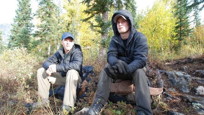 """In this 2012 photo released by National Geographic Channels and Brian Catalina Entertainment, Dallas Seavey, right, sits with his brother Tyrell Seavey at a campsite in Arrigetch Peaks, Alaska. Dallas Seavey, who became the youngest Iditarod champion ever when he won the race in 2012, is among eight mushers or outdoor adventurers featured in the latest reality show set in Alaska. """"Ultimate Survival Alaska"""" premieres Sunday on NatGeoTV. (AP Photo/Brian Catalina Entertainment, Brian Skope)"""