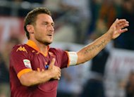 AS Roma's forward Francesco Totti celebrates after scoring a goal during the Italian Serie A football match between AS Roma and Sampdoria at the Olympic stadium in Rome. Totti scored his 216th goal in Italy's top flight, all for Roma, to become the third top scorer in Serie A on Wednesday