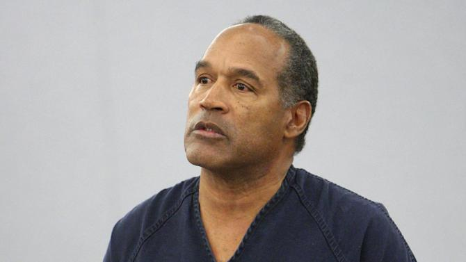 FILE- In this Dec. 5, 2008 file photo, O.J. Simpson speaks during his sentencing  at the Clark County Regional Justice Center courtroom in Las Vegas. Simpson is heading back to the Las Vegas courthouse where he was convicted of leading five men in an armed sports memorabilia heist to ask a judge for a new trial because, he says, the Florida lawyer he paid nearly $700,000 botched his defense. The return of O.J. Simpson to a Las Vegas courtroom next Monday, May, 13,  will remind Americans of a tragedy that became a national obsession and in the process changed the country's attitude toward the justice system, the media and celebrity. (AP Photo/Isaac Brekken, Pool, File)