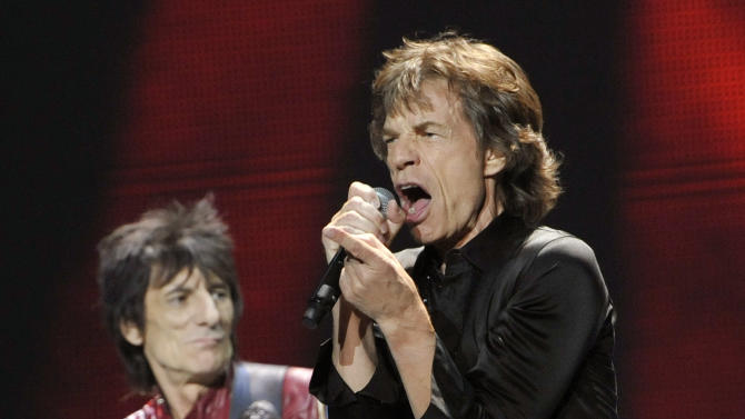 "Mick Jagger, right, and Ron Wood of the Rolling Stones perform on the kick-off of the band's ""50 and Counting"" tour at the Staples Center on Friday, May 3, 2013 in Los Angeles. (Photo by Chris Pizzello/Invision/AP)"