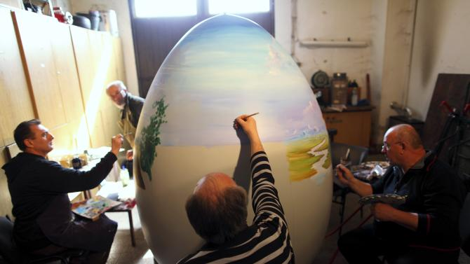 Local artists paint a two-metre-high Easter egg in the traditional naive art style in Koprivnica