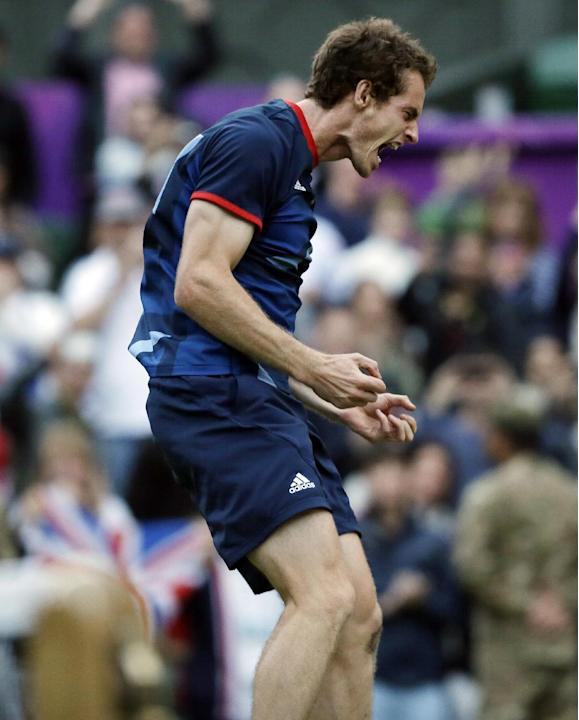 Andy Murray of Great Britain celebrates after defeating Novak Djokovic of Serbia at the All England Lawn Tennis Club in Wimbledon, London at the 2012 Summer Olympics, Friday, Aug. 3, 2012. (AP Photo/E