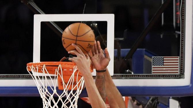 New York Knicks' Amare Stoudemire, left, blocks a shot by Milwaukee Bucks' Giannis Antetokounmpo during the second quarter of an NBA basketball game at New York's Madison Square Garden, Saturday, March 15, 2014