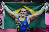 Brazilian gymnast Arthur Nabarrete Zanetti celebrates winning gold in the men's rings final at North Greenwich Arena on Monday