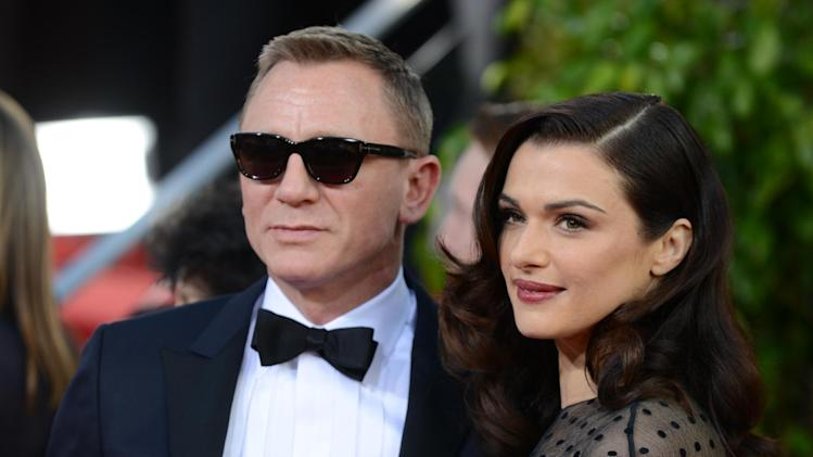 "FILE - This Jan. 13, 2013 file photo shows Daniel Craig, left, and his wife Rachel Weisz at the 70th Annual Golden Globe Awards in Beverly Hills, Calif. Craig and Weisz will star in the play ""Betrayal,"" in October. (Photo by Jordan Strauss/Invision/AP, File)"