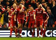 Liverpool's English midfielder Steven Gerrard (3rd L) celebrates scoring during the English Premier League football match between Liverpool and Everton at Anfield in Liverpool. Gerrard scored all three goals as Liverpool won 3-0