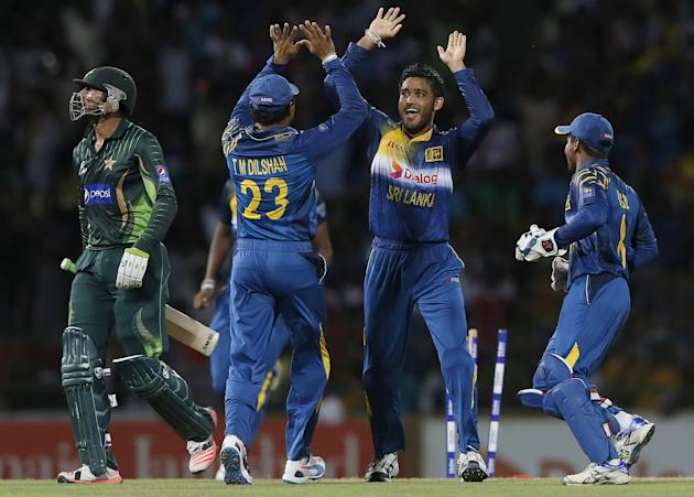 Sri Lanka's Siriwardana celebrates with his teammates after taking the wicket of Pakistan's Malik during their second Twenty 20 cricket match in Colombo