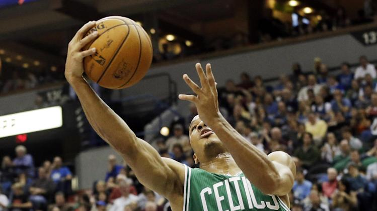 Boston Celtics' Avery Bradley lays up in the second half of an NBA basketball game against the Minneapolis Timberwolves, Saturday, Nov. 16, 2013, in  Minneapolis