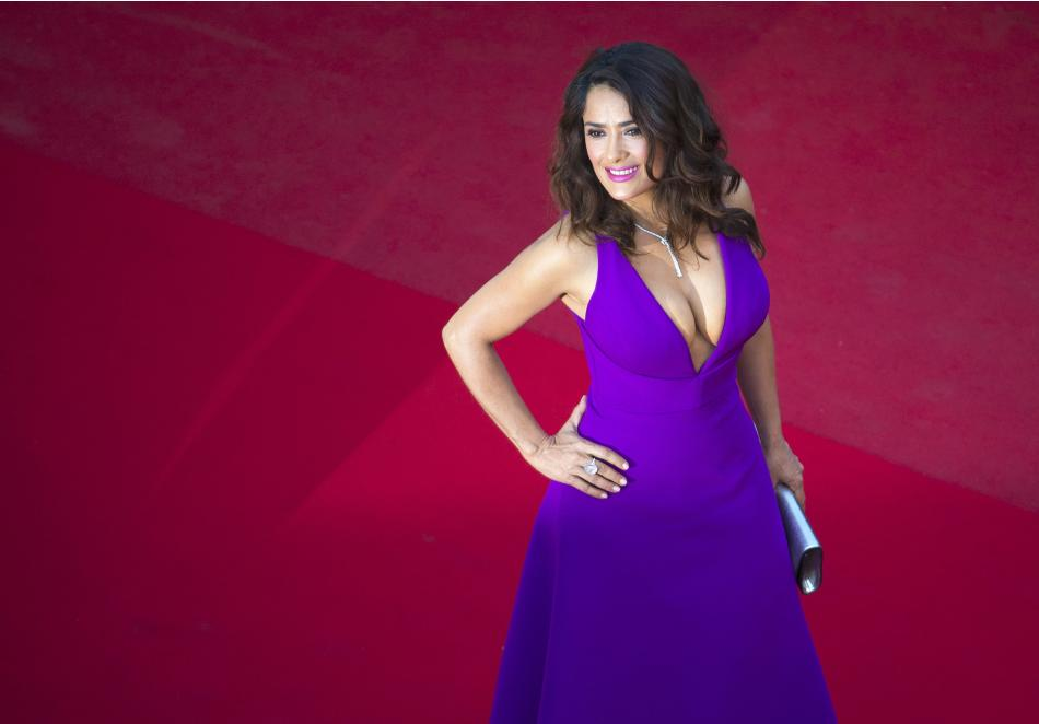 Actress Salma Hayek poses on the red carpet as she arrives for the screening of the film