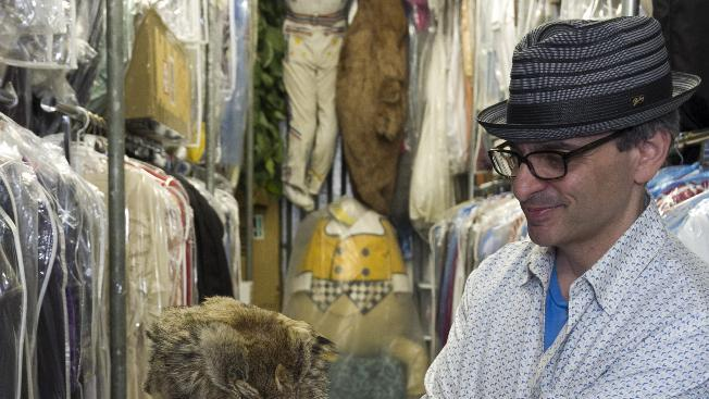 """In this Friday, Nov. 30, 2012 photo, James Comisar shows Fess Parker's """"Daniel Boone"""" coonskin hat worn in the late 1960s television show. The item is part of his television memorabilia collection in a temperature- and humidity-controlled warehouse in Los Angeles. (AP Photo/Damian Dovarganes)"""