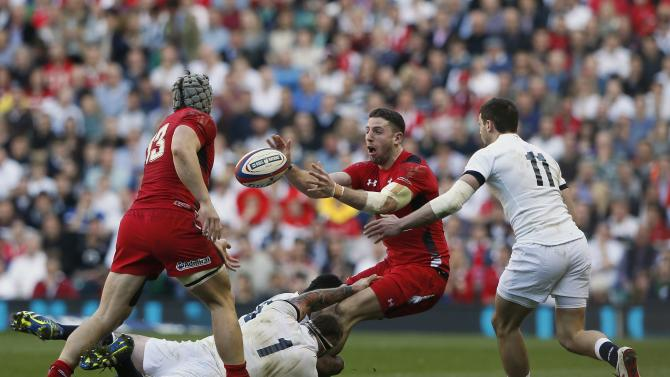 England's Marler challenges Wales' Cuthbert during their Six Nations international rugby union match at Twickenham in London