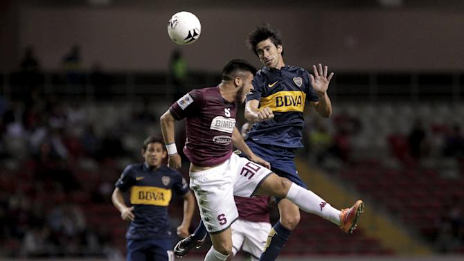 Perez of Argentina's Boca Juniors fights for the ball with Segura of Costa Rica's Deportivo Saprissa during their friendly soccer match at the National stadium in San Jose