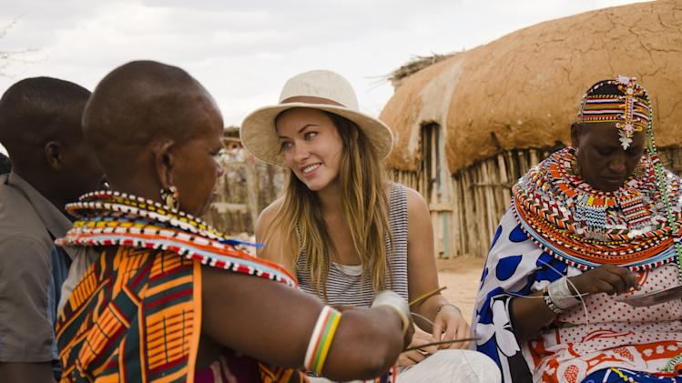 "This undated image provided by PBS shows actress Olivia Wilde in Kenya. Wilde, America Ferrara, and Meg Ryan are among the actresses who brought their star power to the PBS documentary ""Half the Sky,"" which details efforts to help exploited women worldwide. It airs Monday and Tuesday, Oct. 1-2. (AP Photo/PBS, Jessica Chermayeff)"