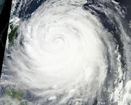 This NASA satellite image shows typhoon Soulik approaching Taiwan, on July 12, 2013. Soulik has battered Taiwan with torrential rain and powerful winds that left two people dead and at least 100 injured