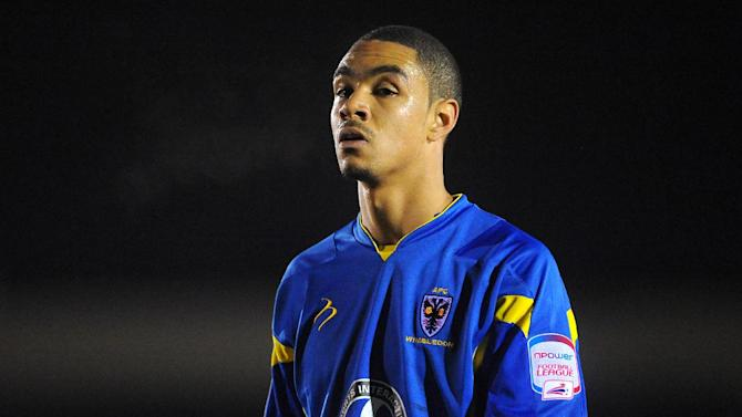 Byron Harrison has faith in AFC Wimbledon's current squad to turn around their fortunes