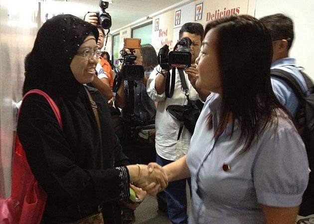 WP's Lee Li Lian, seen here greeting a resident, says she will bring something different to Parliament as a female MP.