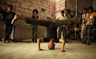 A boy stretches as he exercises at a fitness center in Sanaa September 2, 2013. REUTERS/Khaled Abdullah/Files