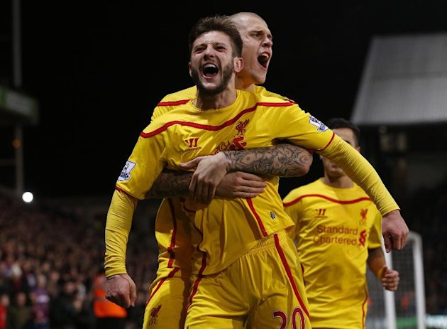 Liverpool's Adam Lallana (L) celebrates with teammate Martin Skrtel after scoring a goal during their FA Cup 5th round match against Crystal Palace, in south London, on February 14, 2015