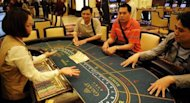 Punters play in the casino of the Galaxy Macau hotel and resort in 2011. Construction for the second phase of Galaxy Macau has started and would expand the size of the property to 1.0 million square metres (10.8 million square feet)