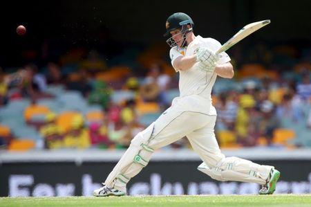 Australian batsman Adam Voges drives a wide delivery during the first cricket test match between Australia and New Zealand in Brisbane