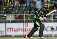 Pakistan's Nasir Jamshed plays South Africa's Lonwabo Tsotsobe's delivery during their first Twenty20 cricket match in Johannesburg November 20, 2013. REUTERS/Siphiwe Sibeko