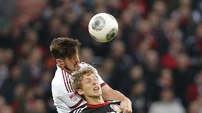 Leverkusen's Stefan Kiessling, front, and Nuremberg's Per Nilsson of Sweden challenge for the ball during the German first division Bundesliga soccer match between Bayer Leverkusen and 1.FC  Nuremberg n Leverkusen, Germany, Saturday, Nov. 30, 2013