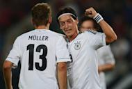 Germany´s midfielder Mesut Oezil (right) and midfielder Thomas Mueller celebrate during the FIFA World Cup 2014 qualifier Group C match Germany vs Faroe Islands on September 7. Germany's star-studded attack has been told to convert more chances in front of goal when they take on Austria in Vienna on September 11 in their second World Cup qualifying match
