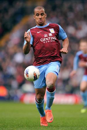 Gabriel Agbonlahor netted a brace as Aston Villa knocked Manchester City out of the Capital One Cup
