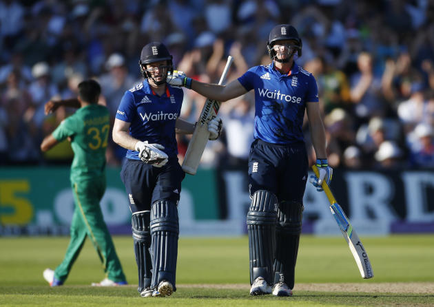 England's Jos Buttler and Eoin Morgan celebrate at the end of the innings after breaking the world record for the highest ODI score