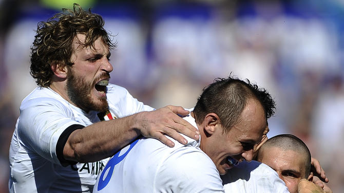 Italy's Giovanbattista Venditti (C) celebrates with teammates after scoring against Scotland during their Rugby Union Six Nations match at the Rome's Olympic stadium on March 17, 2012. Italy defeated Scotland 13-6.  AFP PHOTO / FILIPPO MONTEFORTE (Photo credit should read FILIPPO MONTEFORTE/AFP/Getty Images)