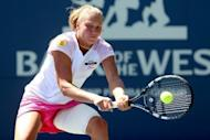 Yanina Wickmayer of Belgium returns a shot to Marion Bartoli of France at the Stanford University Taube Family Tennis Stadium in California. Wickmayer won 6-3, 6-2