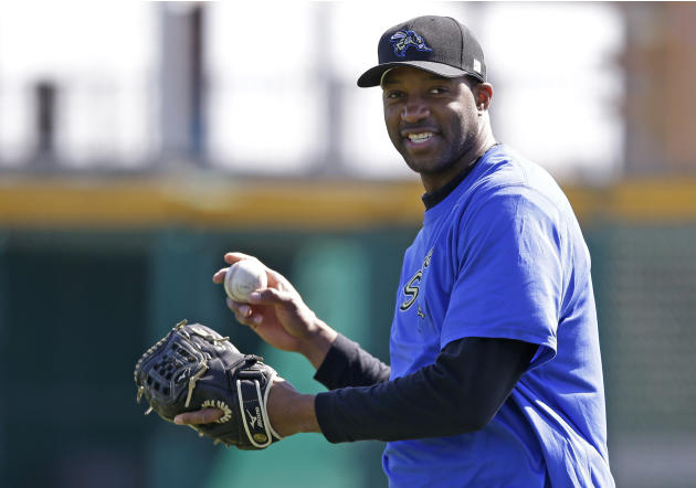 In this Feb. 12, 2014, photo, retired NBA basketball player Tracy McGrady smiles while working out at the Sugar Land Skeeters' baseball stadium in Sugar Land, Texas. McGrady signed Wednesday, Apri