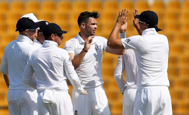 England's James Anderson (C) celebrates taking the wicket of Pakistan's Shan Masood (not pictured)