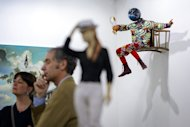 "Yinka Shonibare's sculpture ""Champagne Kid (Perching)"" is pictured at an Art Basel preview on June 11, 2013. Collectors from around the world have flocked to Switzerland this week for Art Basel, the biggest contemporary art fair on the planet"