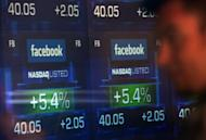 Screens display the start of trading in Facebook shares at the NASDAQ stock exchange in Times Square in New York in May 2012. After a dire stock market debut, Facebook has clawed back a large chunk of its losses as investors look past the flubbed initial public offering and gradually warm to the leading social network