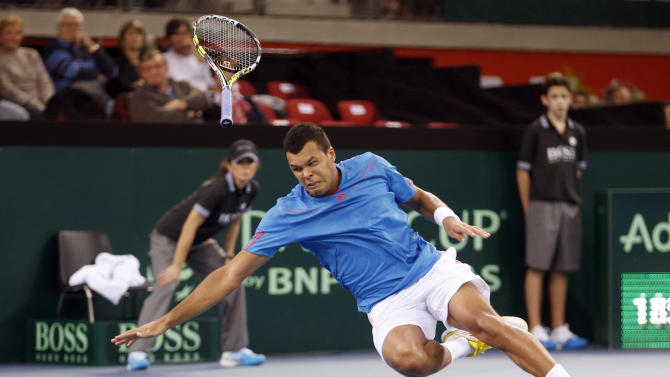 Tsonga of France falls during his first round Davis Cup tennis match against Weintraub of Israel in Rouen