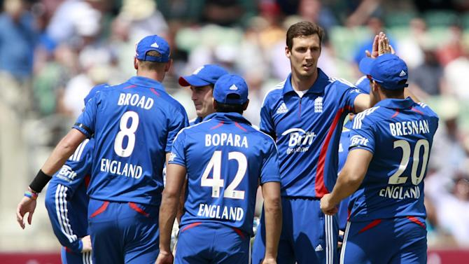 Steven Finn (facing) removed Australia opener Shane Watson