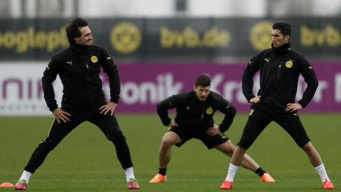 Borussia Dortmund's Jojic, Hummels and Sahin warm up during a training session in Dortmund