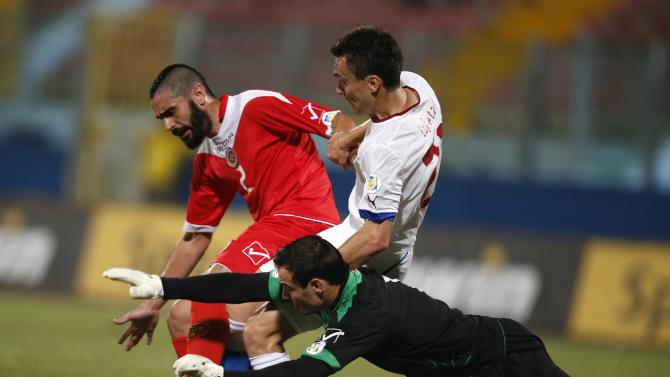 Malta's goalkeeper Haber, Malta's Jonathan Caruana and Czech Republic's Lafata fight for the ball during their 2014 World Cup qualifying soccer match outside Valletta