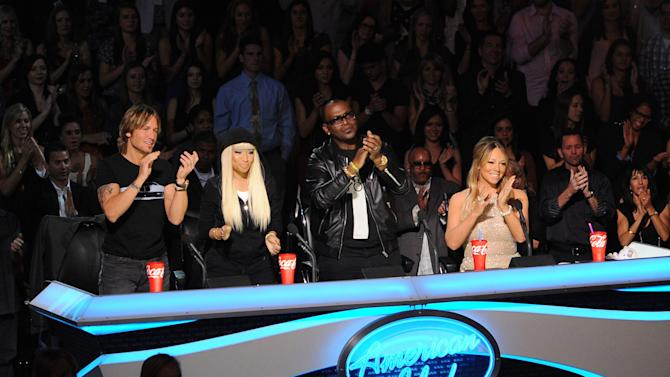 "This undated image released by Fox shows judges, from left, Keith Urban, Nicki Minaj, Randy Jackson and Mariah Carey from the singing competition series, ""American Idol,"" airing Wednesdays and Thursdays on Fox. In its 12th season, ""American Idol"" is managing to hit the right notes with sponsors if not always with fickle viewers. It has retained its status as TV's advertising leader among series and the loyalty of its biggest backers, including Ford and Coca-Cola. (AP Photo/Fox, Frank Micelotta)"
