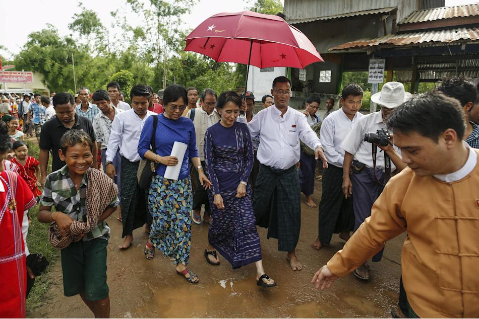 Suu Kyi walks in Warheinkha village