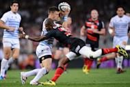 Castres' scrum half Rory Kockott is tackled by Toulouse's winger Timoci Matanavu (C) during a Top 14 rugby match in Toulouse's stadium. Former champions Toulouse secured their place in the final of the French Top 14 championship with a 24-15 semi-final win over Castres